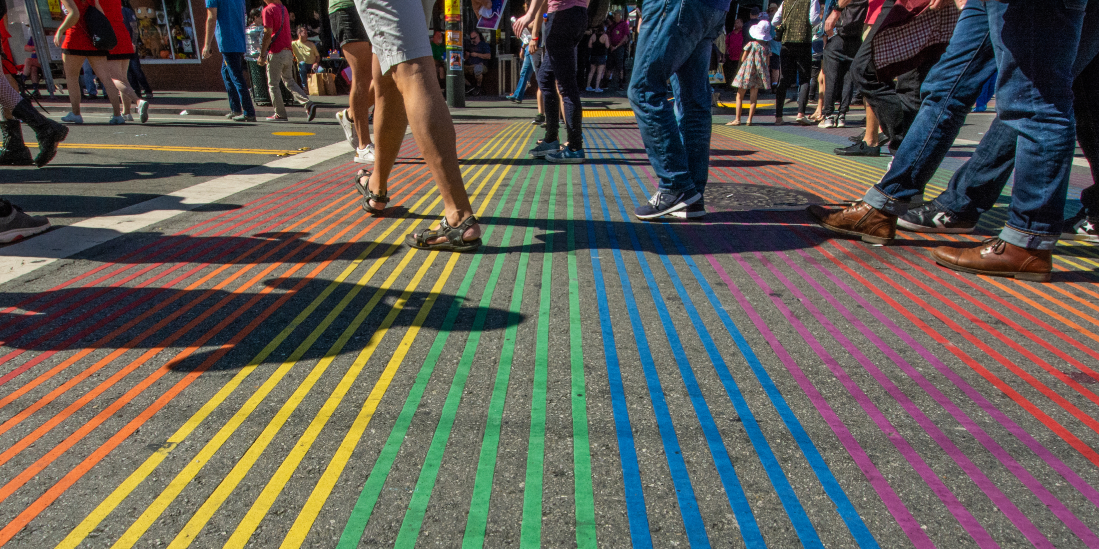 People walking on the Castro rainbow cross-walk